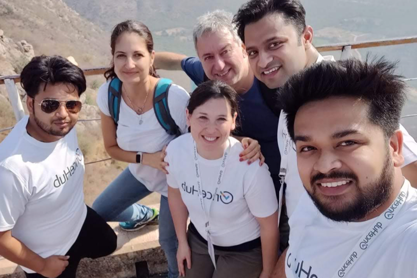 OnceHub employees pose for group photo on hike